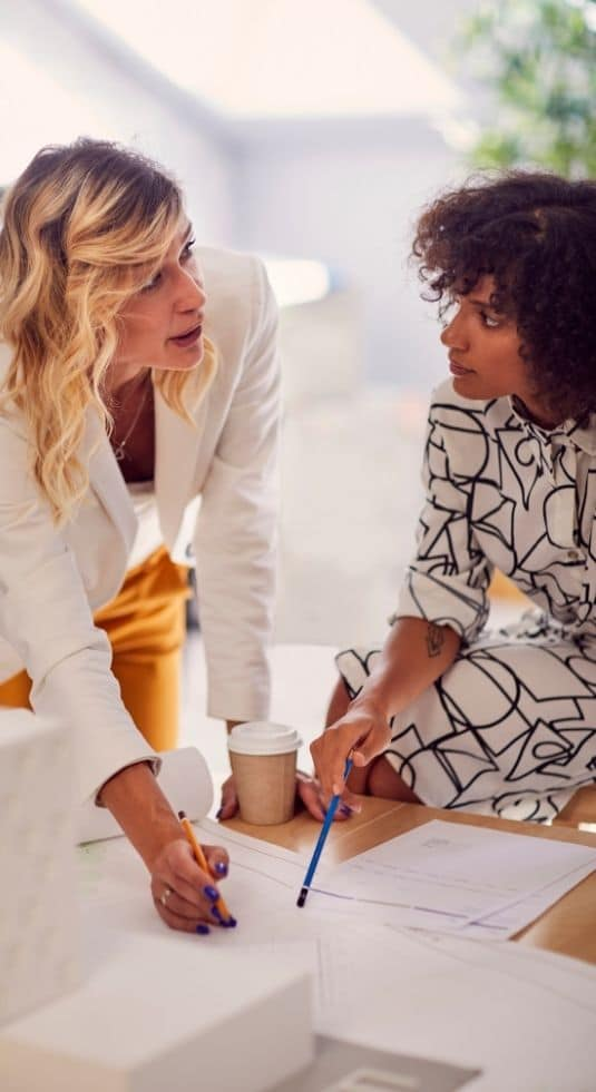 Two women discussing payrolling services